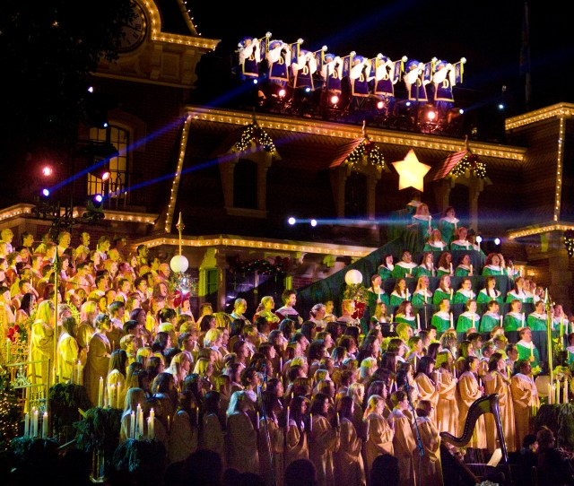 Singers From Throughout Southern California Assembled On The Steps Of The Main Street Usa Train Depot For Disneylands 2013 Candlelight Ceremony