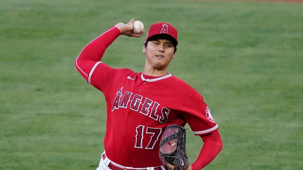 Los Angeles Angels starting pitcher Shohei Ohtani (17) throws during a baseball game against the Seattle Mariners Friday, June 4, 2021, in Anaheim, Calif. (AP Photo/Ashley Landis)