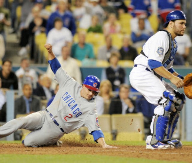 Chicago Cubs Ryan Theriot Left Scores On A Single By Kosuke Fukudome As Los Angeles Dodgers Catcher Russell Martin Waits For The Ball During The Ninth