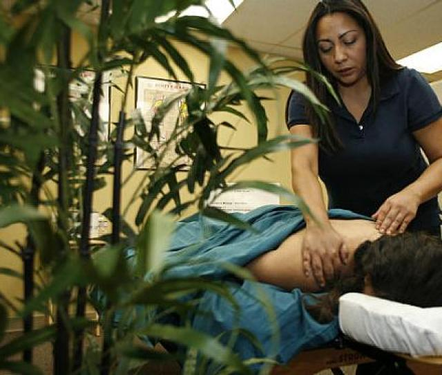 Angela Rodriguez A Certified Message Therapist Demonstrates Massage Techniques On Student Erika Medina At Lincoln Institute Of Body Therapy In Orange In