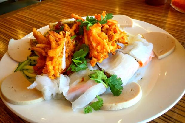 Combo No. 1 at Banh Cuon Tay Ho #4 includes banh cuon (wide rice noodles) and banh tom (sweet potato and shrimp fritters). (Photo by Brad A. Johnson, Orange County Register)