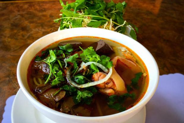 Bun Bo Hue is hearty noodle soup made with beef, blood pudding and pork knuckles, shown here at Quan Vy Da. (Photo by Brad A. Johnson, Orange County Register)