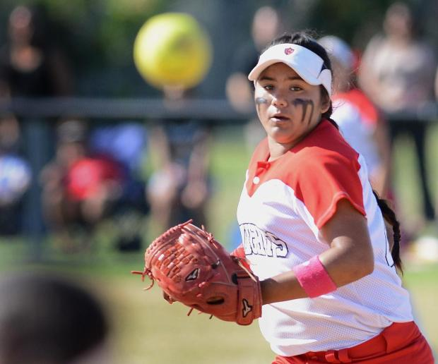 Katella's Stephanie Rojas threw to first for a force out during her game against Paraclete on Tuesday.