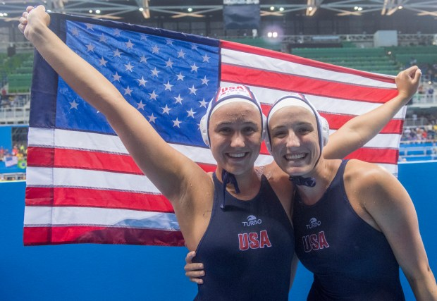 Laguna Beach sisters, Aria Fischer and Makenzie Fischer celebrate after their goal medal victory against Italy at the 2016 Summer Olympics in Rio de Janeiro, Brazil, Friday, Aug. 19, 2016.