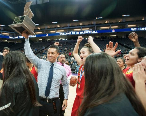 Rosary coach Richard Yoon, left, holds up the CIF State Division III Championship plaque after defeating Campolindo at Golden 1 Center in Sacramento on Friday, March 24, 2017. (Photo by Kyusung Gong/Orange County Register/SCNG)
