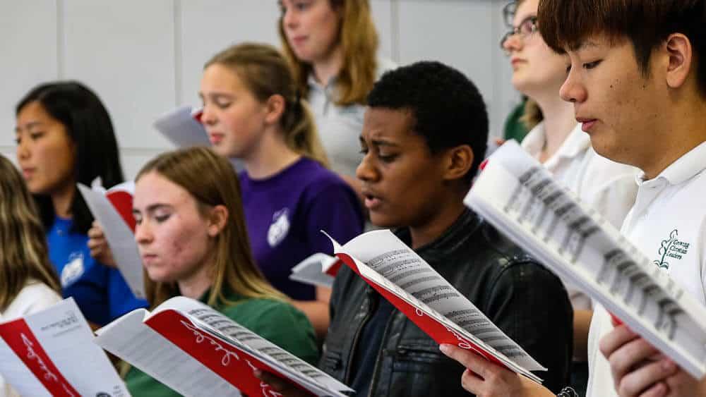 Choir rehearsal before the fine arts concert at Ontario Christian High School