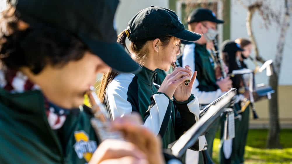 The pep band marching band performs at Ontario Christian High School