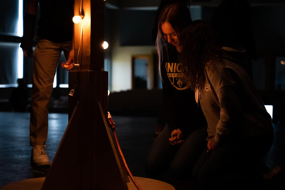 High school students reflect in prayer during Good Friday