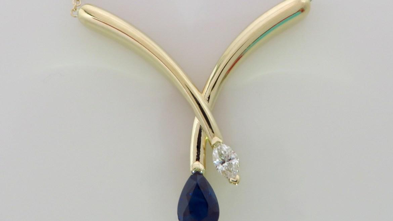 pendentif en or 10 k jaune sertis d'un saphir et d'un diamant