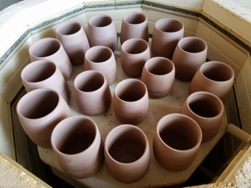 pottery ready to be bisque fired