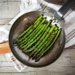 Close-up of healthy frying asparagus with salt on panClose-up of healthy frying asparagus with salt on pan