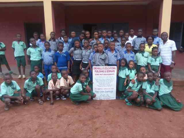 Cross section of pupils and Students of New Generation Schools, Ekwulobia, with primary6 Teacher, Ajaegbu Olileanya and the Award winning Author, Paul Chika Emekwulu in a pose after a mentoring clinic at the school yesterday