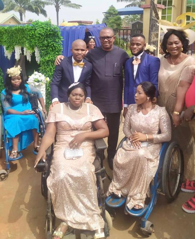 PHOTO: Back row: from Right, Mrs. Rosemary Odunukwe, Proprietor of Recdot Centre for the Physically Challenged; the newly wedded, Samson Fidelis and wife, Gloria (seated on the right); Mr. Peter Obi, the Father of the Day, and another newly wedded, Ikenna Ibeadua and wife, Judith (seated on the left), after their wedding at St. Aloysius Church of Divine Mercy, Recdot Centre, Ozubulu, on Monday.