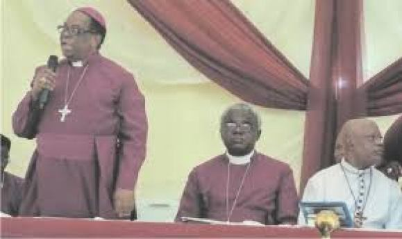 Former Archbishop on the Niger, Most Reverend Maxwell Anikwenwa (standing)