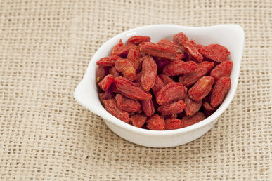 organic goji berries (wolfberry) in a small ceramic bowl - HImalayan superfood