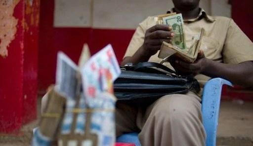 Cambiste RDC Dollars Franc Congolais