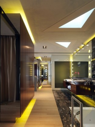 restroom with yellow light by LED lanterns