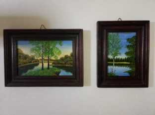 Two pictures of nature painted on wood
