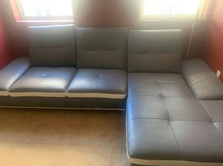 "Grey Leather With White Trim Two Piece Couches-GREAT condition Leather couches 2 piece , if you're interested message me   , 10 /10 barley been used. paid 2,300$ for them Moved out to the east side of Vegas but the couches are still on Decatur & Alexander.   Pick up only , If you pick up , The price is negotiable. Thank You .     location- Decatur & Alexander  Serious Buyers Only THANK YOU .   "" cash money or cash app """