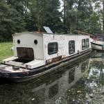 stuk grond aan het water omg amsterdam om zelf boot te verbouwen.