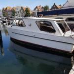 Stalen kajuitbootje 7.4 meter 3000 kg van Zeeland naar Amsterdam