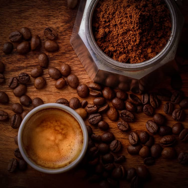 image of ground and whole coffee