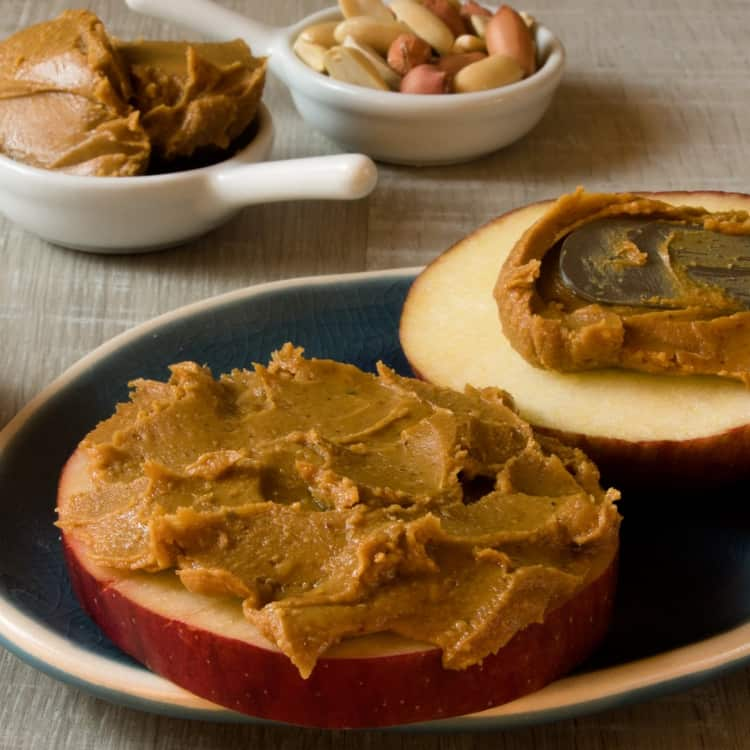 image of apples and peanut butter as a healthy snack for work