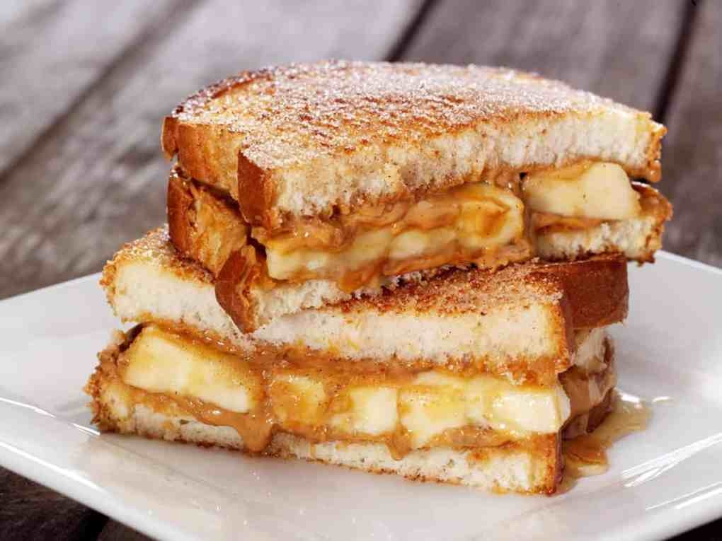 image of a banana and peanut butter sandwich as a healthy snack for work