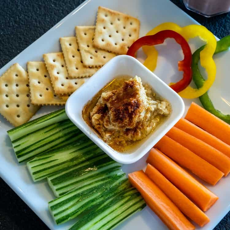 image of hummus and carrots as a healthy snack for work
