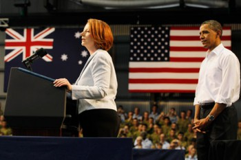 U.S. President Barack Obama looks at Australian Prime Minister Julia Gillard speak to Australian troops and U.S. Marines at Royal Australian Air Force Base in Darwin, Australia, Thursday, Nov. 17, 2011. Australia decided in November 2011 to host a permanent US military presence in Darwin. America has signalled it will station up to 2500 troops, in addition to bombers, fighters, tankers and spy planes, followed by navy ships and submarines to be based in Perth.