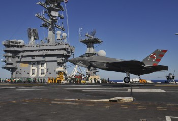 A U.S. Navy Lockheed Martin F-35C Lightning II of Air Test and Evaluation Squadron 23 (VX-23) conducts it's first arrested landing aboard the aircraft carrier USS Nimitz (CVN-68) in the Pacific Ocean in November 2014. (Photo: Mass Communication Specialist 3rd Class Kelly M. Agee / U.S. Navy).