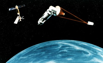 1984 artist's concept of a generic laser-equipped satellite firing on another.