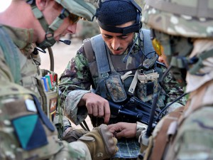 Sergeant Richie Burwell, 1 Royal Irish and Sergeant Mivullah Afghan National Army, check the route of the Afghan Army led patrol. The B Company of 1st Battalion The Royal Irish Regiment are forward mounted into Patrol Bases and Check Points within the Nad-e-Ali area of Helmand. The B Company supports an Afghan National Army Tolay (100 Afghan soldiers). This is a partnership; however the ANA take the main lead in all aspects, providing security to the population of Char-e-Mirza.