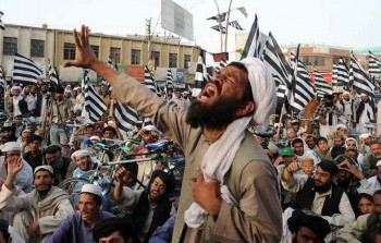 Supporters of the hardline Islamist group Jamiat Ulema-i-Islam-Nazaryati (JUI-N), a pro-Taliban party, shout slogans during a protest in Quetta on May 26, 2009, against the military operation against Taliban militants in Swat and Buner Valleys. Pakistani troops fought street battles struggling for control of Swat valley's capital as fears grew of a looming catastrophe for people trapped by the anti-Taliban offensive. Nearly 2.4 million people have fled as Islamabad struggled to wrest back Swat and nearby districts from the Taliban, whose two-year insurgency had torn apart an area once popular with tourists for its peaks and pristine ski slopes (Photo: Banaras Khan / AFP / Getty Images).