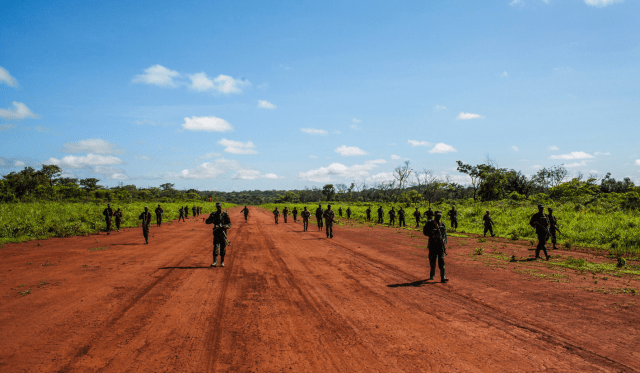 American Green Berets and Uganda People's Defense Force soldiers at an airstrip in Obo, Central African Republic (Photo: Michael Christopher Brown for The New York Times).