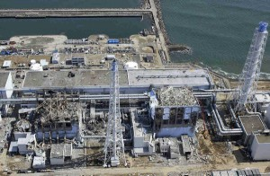 In this March 24, 2011 aerial photo taken by a small unmanned drone and released by AIR PHOTO SERVICE, damaged Unit 3, left, and Unit 4 of the crippled Fukushima Dai-ichi nuclear power plant are seen in Okumamachi, Fukushima prefecture, northern Japan. (Air Photo Service Co. Ltd., Japan)