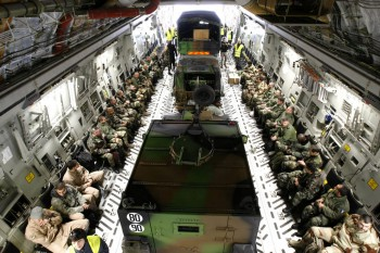 French military personnel and their vehicles, aboard a U.S. Air Force transport aircraft before departing for Mali from Istres airbase, near Marseille, France, on January 24, 2013 (Photo: Claude Paris).
