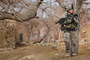 U.S. Army Sgt. Joseph Redhair clears a wooded area outside a village in the Tangi Valley, Wardak province, Afghanistan, March 8, 2009. DoD photo by Fred W. Baker III