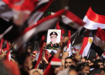 Protesters, who are against Egyptian President Mohamed Mursi, hold a poster featuring the head of Egypt's armed forces General Abdel Fattah al-Sisi in Tahrir Square in Cairo July 3, 2013 (Photo: Mohamed Abd El Ghany / Reuters).