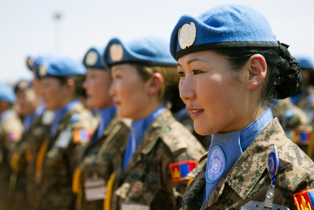 Mongolian peacekeepers of the UN Mission in the Republic of South Sudan (UNMISS) stand in formation during a medal ceremony at their base in Bentiu (UN Photo: Martine Perret, 08 November 2013).