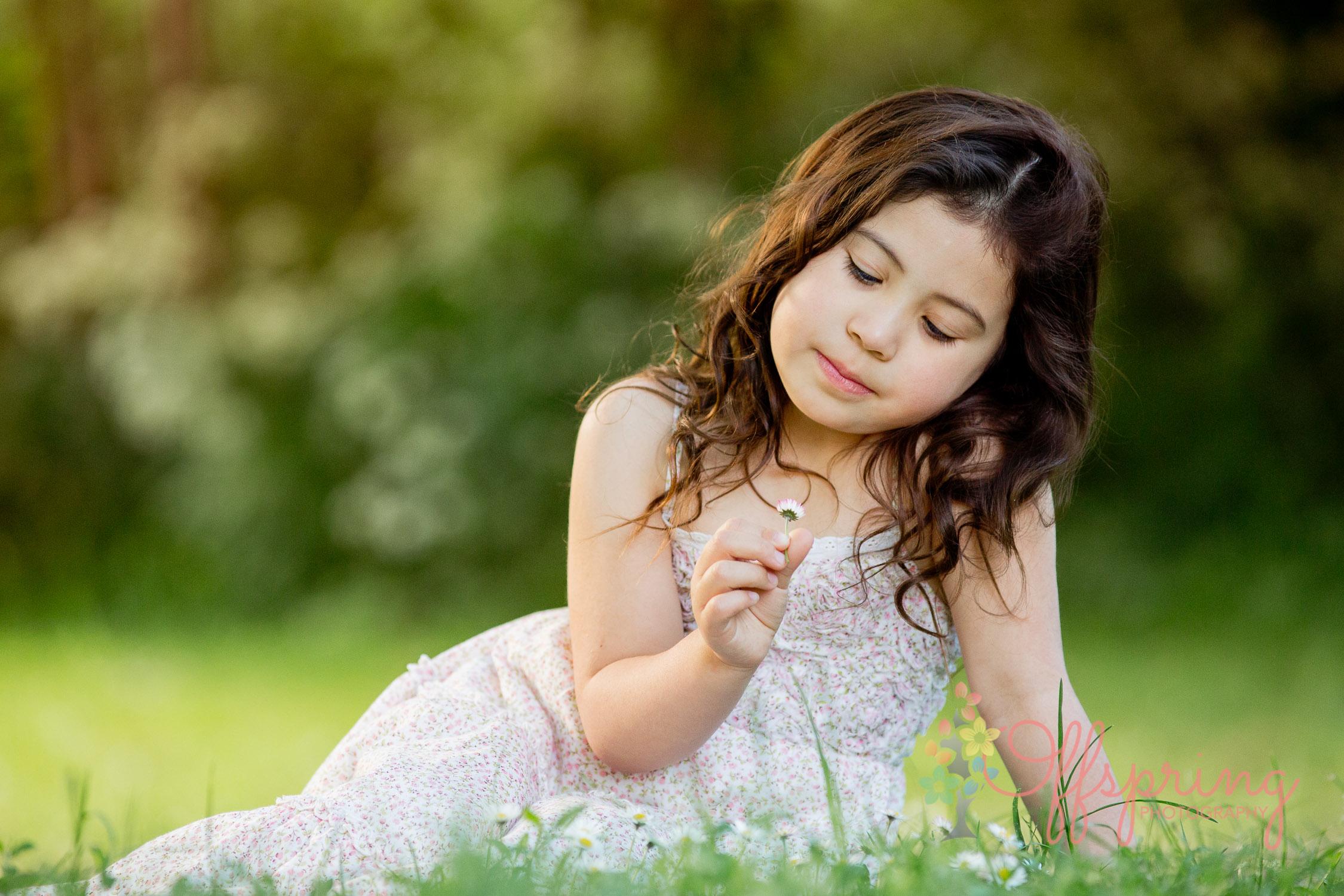 girl-picking-daisy-in-evening-sunlight