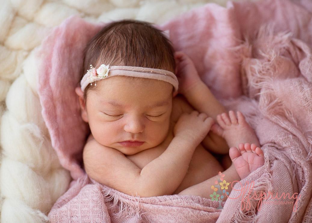 newborn close up in pink