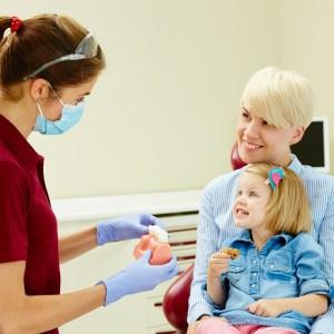 pediatric dentist explaining cre to patients