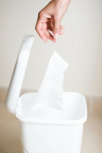 dispose tissues in a no touch wastebasket