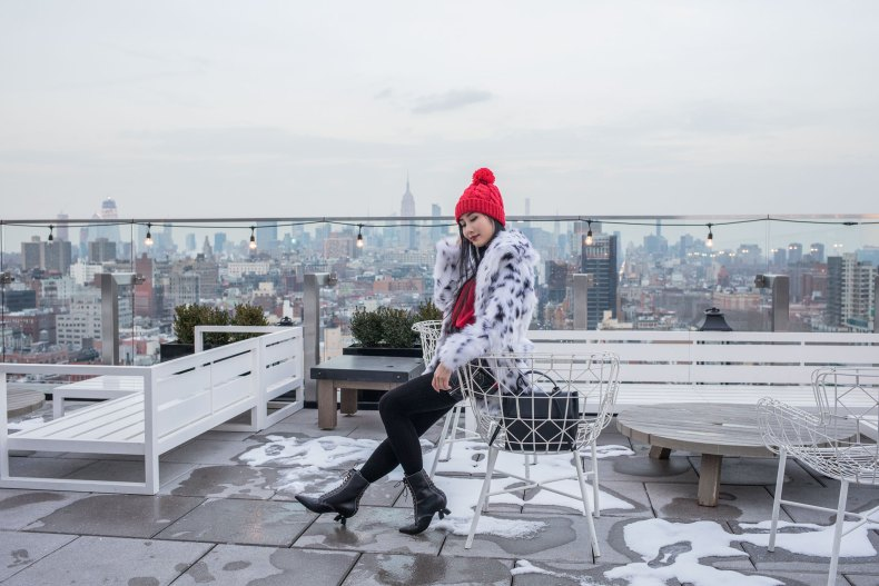 How to Achieve a Stylish Winter Outfit in NYC - Red Pom Pom Beanie, Cable Knit Tights, Leather Skirt, Loewe Lace Up Boots, Red Knit, Spotted Fur Coat, Black XNihilo Bank Bag, Asian Blogger, NYC Fashion Blogger | in NYC | Ofleatherandlace.com