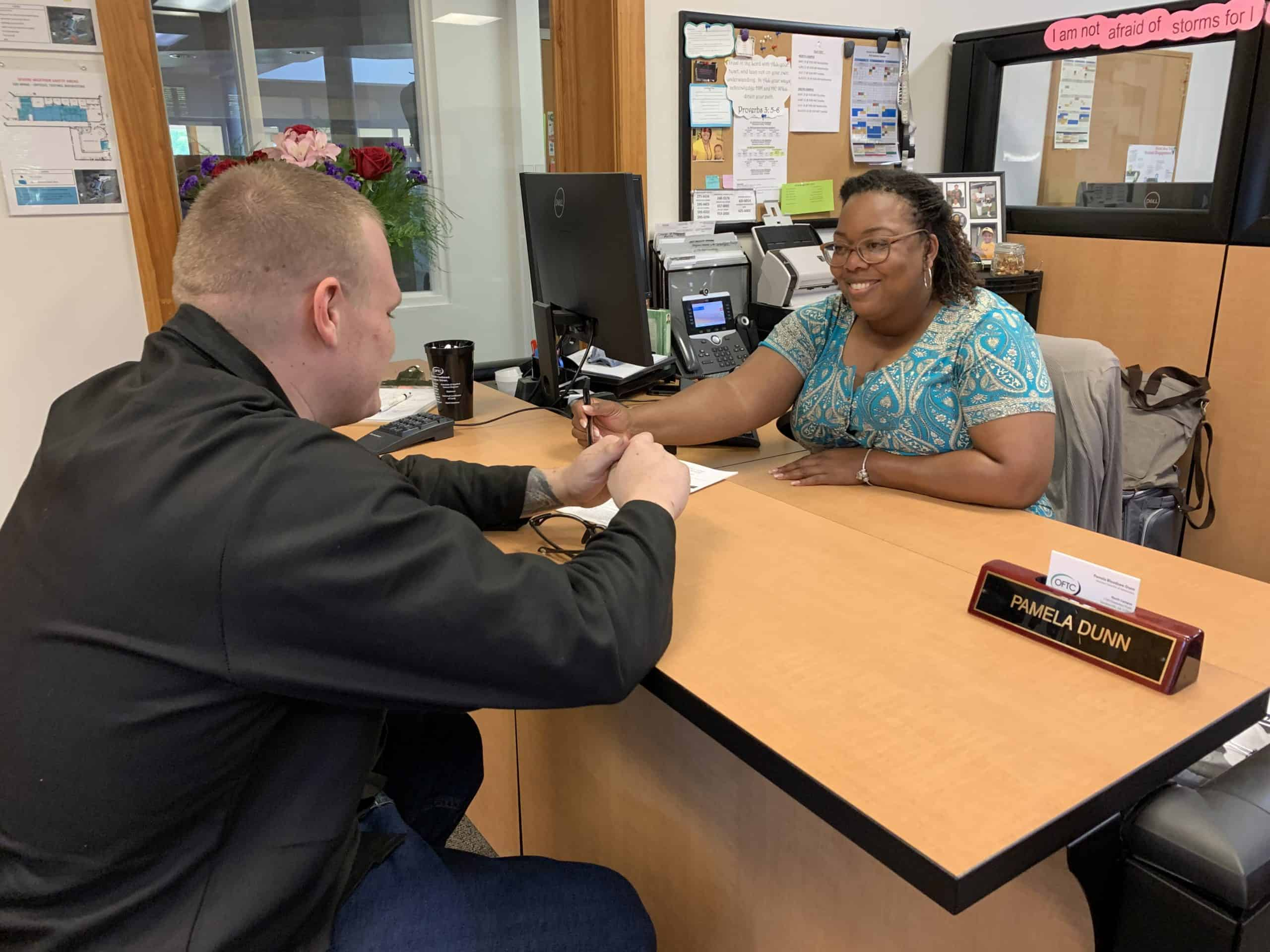 person in the OFTC Admissions Office applying for college