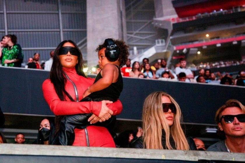 Kim Kardashian protects her son Psalm's ear, two, at Kanye's audition event