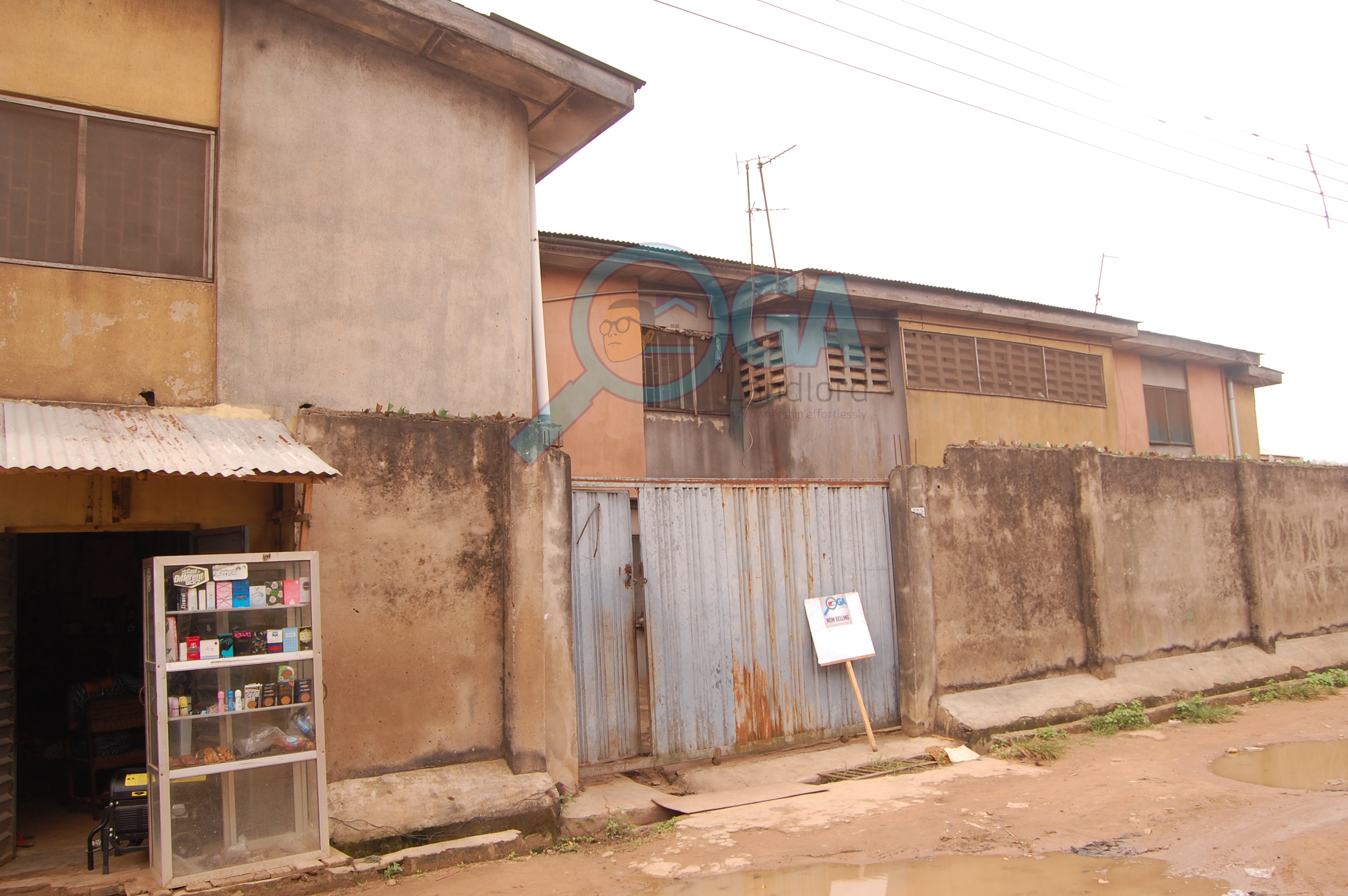 A 2 Plot Fenced Compound with 2 Bungalows for Sale at Sango Otta, Ogun State
