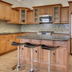 A beautiful kitchen with the CO66 Cinnamon Maple cabinets.