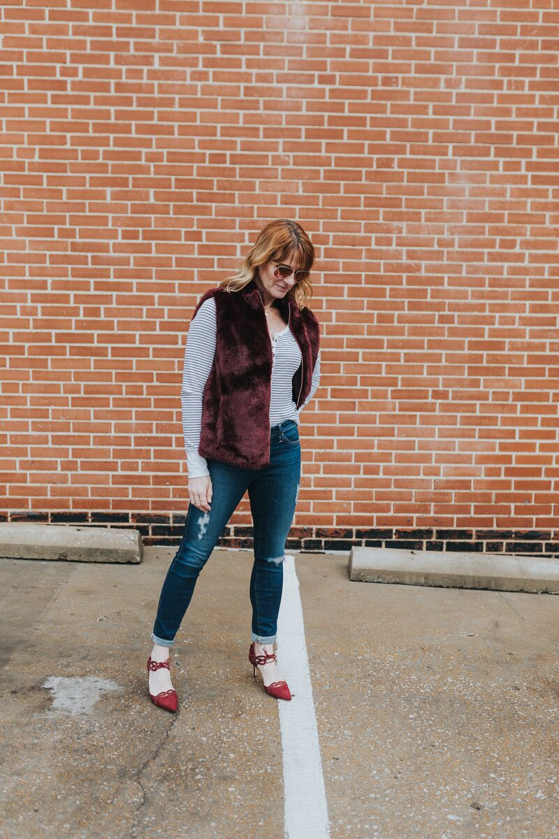 Katie Shelton shares how to wear a henley tee with faux fur vest